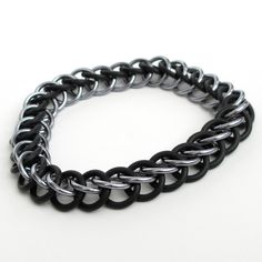 Half Persian stretchy chainmaille bracelet, black and gray. $16.00