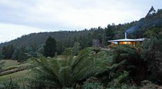 This striking house, located at Neika in southern Tasmania, was originally designed in 1972 by Architect Fred Hudson. Composed of four hexagonal pavilions, the house was carefully constructed on a bench site in the foothills of Mount Wellington. The new owners, who use the house as their mountain 'shack'—a place to escape on weekends or snowy days—felt that the property needed updating to create the restorative family environment they wanted.  By JAWS Architects