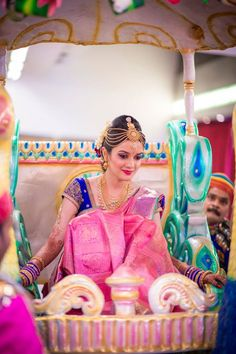 Bride in Pink and Blue Silk Saree