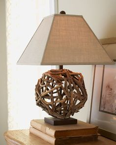 Rounded base Driftwood lamp.  Finding the right shade might be a challenge but this one is perfect.