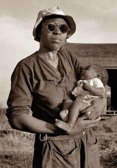 This is a picture of the wife and baby of a farm hand on a plantation in Mississippi. The picture was taken in 1937.