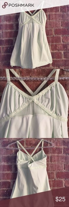 Lululemon performance tank with drawstring waist Classic lululemon piece. Performance sweat wicking material.  Criss-cross back, built in bra, drawstring waist, and mesh insert under bust.  Great for all exercise or casual wear! In great condition, no signs of wear, no piling. lululemon athletica Tops Tank Tops