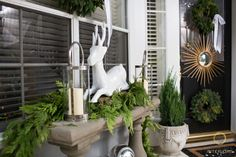 lanterns and deer figurine on the porch console