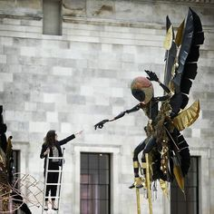 Wander into the British Museum's Great Court these days, and you'll encounter two large, black and gold Moko Jumbie sculptures guarding the staircases on either side.