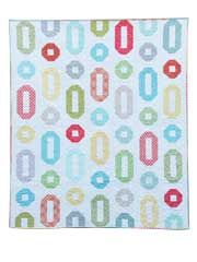 "Ring Toss Quilt Pattern  Have fun creating this quilt as a throw or bed quilt using your favorite jelly roll strips.    Finished sizes:    Throw: 58"" x 68"" using 36 - 2 1/2"" strips  Twin: 66"" x 89"" using 52 - 2 1/2"" strips  Full/Queen: 82"" x 89"" using 65 - 2 1/2"" strips"