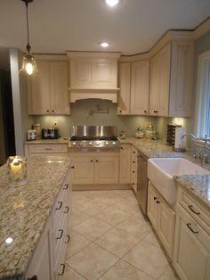 Granite countertops and cream kitchen cabinets. Interior design by SKD Studios skdstudios.com