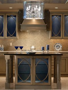 This kitchen is a version of a traditional classic with some contemporary flavor. When considering how to redefine a space, make function the key consideration. To really stand out, add functionality that is out of the ordinary and do it well. This creates a custom feel and a sense that the space is of an expensive quality.