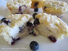 Blueberry Cream Cheese Muffins ~ Just look at the picture...juicy blueberries nestled into moist muffins with tangy smooth cream cheese surprises throughout with a crunchy crumb topping.  These muffins look simply divine!