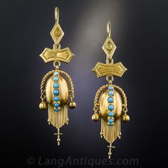 A rare and ravishing pair of nineteenth century Victorian earrings, superbly handcrafted in velvety 14K gold. Designed in three sections, the egg shaped center is dotted with tiny turquoise colored beads with delicate tassels dancing below, culminating in a cross motif. The gold beads on the sides also jingle. Circa 1875. Just shy of 2 1/2 inches long and absolutely lovely.