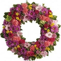 Choose from our beautiful range of wreath and spray sympathy flowers. We can arrange funeral flower delivery to the funeral home or to the families home