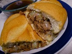 "Crock Pot French Dip Sandwiches. Pinners say this one is a family favorite! Awesome for big parties, like the Superbowl!  2-3 lb oven roast  2 cans beef broth (about 4 cups)  2 pkgs Lipton Onion Soup Mix  white Italian sub rolls (We get ours from Subway, they sell a 12"" roll for 50 cents!)  provolone cheese slices    Put oven roast in crock pot. Add beef broth & soup mix. Cook on low 7-8 hours. Shred roast with a fork, and return shredded beef to crock pot for a few more minutes."