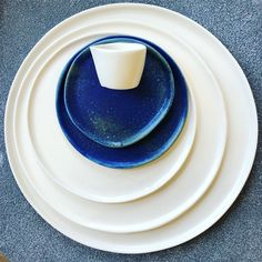 HAAND Skali and Ripple dinnerware in Matte White + Blue Ash. Blue Ash, Bar Displays, Raw Bars, Coffee Service, White Dinnerware, Glazes For Pottery, Natural Shapes, Rustic Table, Creative Home