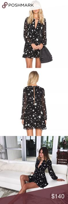 Lover's and friends Lana star print dress Lovers + Friends Lana dress in Black star print  Size M (runs small)  Poly blend  Hand wash cold  Fully lined  Neckline keyhole with metal bar accent  Back keyhole with button closure  Hidden side zipper closure  As seen on Ashley Benson and fashion blogger Jessica Stein. Lovers + Friends Dresses Mini