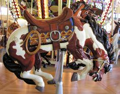 Riverfront park Carousel - outside row bucking horse with gold tooth.  Photo by Gary Nance, 2006