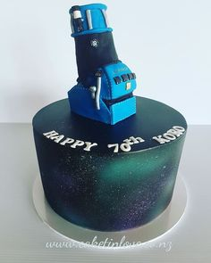 "10"" lemon cake decorated in a airbrushed galaxy effect with his start gazing telescope on the top."