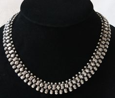 Beautiful antique silver necklace from a famed jeweler in Vientiane during the French occupation of Laos at www.sabaidesignsgallery.com