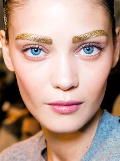 Golden brows on Diana Moldovan by Pat McGrath for Christian Dior Spring/Summer 2014