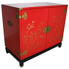 1950s Red Chinoiserie Cabinet with Gold Leaf Relief | From a unique collection of antique and modern cabinets at http://www.1stdibs.com/furniture/storage-case-pieces/cabinets/