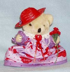 Teddy Bear in a red hat with purple dress, roses, pearls