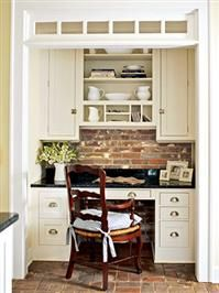 Pretty built-in desk with brick wall in kitchen