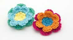"""Crochet Flower Patterns.  Includes instructions for small and large flowers (shown """"stacked"""" together for tri-color effect)."""