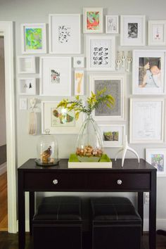 Love the wall of white frames .. Falling It Up | Young House Love