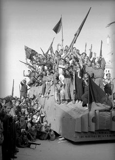 Spanish Civil War. Militia men and women stand on a homemade tank in Barcelona on Aug. 28, 1936.