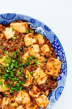 Chinese Sichuan Cuisine: Mapo Tofu - Pockmarked-Face Lady's Tofu. [Ma Po is an elderly woman whose face was pockmarked. Tofu (bean curd) in spicy chili-, and bean-based sauce. Cooked with minced pork, or beef. It exists with other ingredient such as water chestnut, onion, other vegetable, or Judae's Ear aka Jelly Ear (mushroom).]