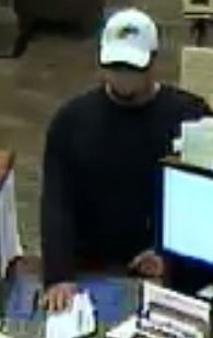 On 06/25/14 at 11:40 am, this suspect entered the BMO Harris Bank located at 2251 Route 59 in Joliet and passed the teller a note demanding money. The suspect is described as a white male with a goatee, wearing a white baseball cap, black long sleeve shirt, and blue jeans. Anyone that can identify the suspect, please contact the Joliet Police Department's Investigation Division at (815) 724-3020.
