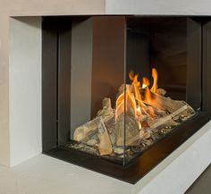 Don't have the full for a full-scale fireplace? Discover the top 70 best corner fireplace designs featuring luxury angled interior ideas and inspiration. Modern Fireplace, Living Room With Fireplace, Fireplace Design, Fireplace Ideas, Wall Mount Electric Fireplace, Fireplace Remodel, Interior Ideas, Interior Design, Herd