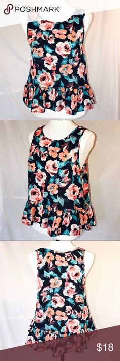 """LA Hearts PacSun Navy Chiffon Peplum Floral Top Light flowy semisheer Chiffon tank top from LA Hearts at PacSun is Navy with bold Aqua and coral Floral print.  Ruffled Peplum hemline.  Sleeveless.  Size Small.  Approx measurements: chest across laying flat 18"""", front length 22"""", back length 24"""".  100% polyester.  In perfect like new condition. La Hearts Tops Tank Tops"""