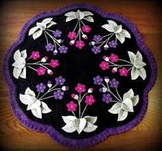 """Hand Stitched """"Violets In My Garden"""" Wool-Felt Penny Rug - Candlemat."""