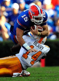 df1436f51 Tim Tebow of the Florida Gators is tackled by Eric Berry of the Tennessee  Volunteers during the game at Ben Hill Griffin Stadium on September 2009 in  ...