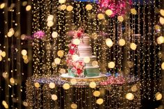 Cake table with curtain of lights