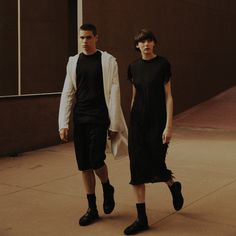 Damir Doma SS16 Collection At Aldo Rossi Gallaratese Building, Milano: Him - Coria Sweat Coat, Selya Long Sleeves T Shirt, Poline Drawstring Shorts And Flash Runner, Her - Dires Dress And Flash Runner. Visit Our Online Store: shop.damirdoma.com