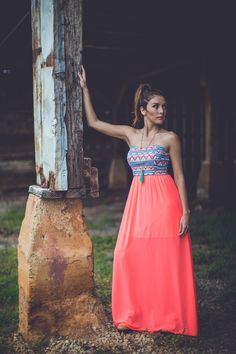I have the same Neon Aztec Maxi in Coral and love to wear it when I go out. The perfect party dress