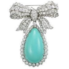 A David Webb Turquoise and Diamond Brooch.