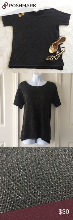Black and Gold Shimmer Knit Top Black tank top lining topped with a semi-sheer black and shimmery gold knit top. Shell: 81% polyester, 19% lurex. Lining: 95% rayon, 5% nylon. Looks great on its own, or layered under a blazer or moto jacket! No trades, no PayPal. Skies are Blue Tops Tees - Short Sleeve