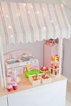 Kids play shop with kitchen and accessories.