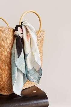Botanical scarves for your hair, your tote, your waist, and more. Scarf On Bag, Fashion Office, Scarf Display, Fabric Photography, Head Scarf Tying, Older Women Fashion, Textiles, Scarf Hairstyles, Crochet Bags