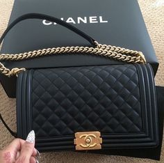 Chanel Black Leather Boy Bag. Ugh I can dream right???