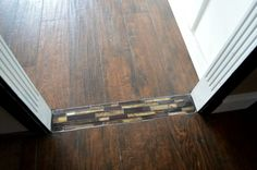 Have you ever had an awkward flooring transition that you simply didn't know what to do with it? Background:  I had a water leak in my kitche…
