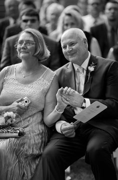 Parents of the bride during wedding ceremony | wedding photo by cindy brown