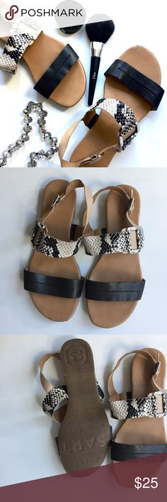 Black and White Sandals Black and white sandals. They have hook closure around the sandals. Used good condition. Shoes Sandals