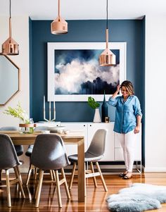 Swooning over this gorgeous space filled with pops of blue + blond wood accents.