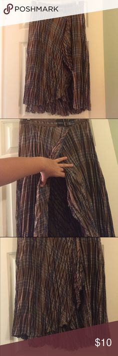 """Bandolino Western Skirt Bandolino western style high-low wrap skirt.  65% polyester, 35% rayon.  Machine washable.  Brown, tan and blue plaid pattern.  27"""" long in the front, 32"""" long in the back.  Faux belt at waist (just for looks).  Zipper close on side.  EUC Bandolino Skirts High Low"""