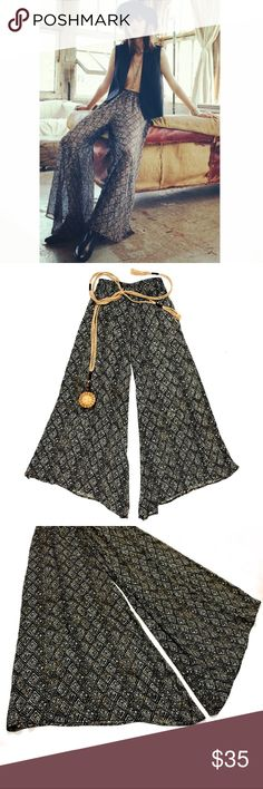 "OFFER‼️Band Of Gypsies Sheer Wide Leg Pants Extra wide leg sheer pants by Band Of Gypsies from Revolve. Elastic waistband on the back with non-stretch waistband on the front for a clean look. These are super wide! Awesome lightweight chiffon fabric falls gracefully on the figure and is so, so comfy! Black & white diamond print with copper details.   •Like new, perfect condition  •100% poly •Size small •W: 24""-33"", L: 43"" •Machine wash  🖤15% off bundles of 2+!  🖤Check out my other items…"