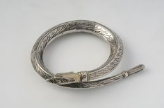 "Viking bracelet, silver and gilded. The bracelet is in Ringerike-style and shaped as an animal. Hoard find, Undrom, Sweden. Object from the exhibition ""We call them Vikings"" produced by The Swedish History Museum."