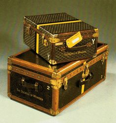 Just two of the types of luggage Wallis Simpson took with her on her travels. Both were made by Goyard of Paris in the 1940s. On top is a document case lined in yellow silk satin and on the bottom a trunk lined in cream silk. Notice 'The Duchess of Windsor' prominently labeled on the luggage. Wallis did use luggage tags, one with her title and Paris address stamped on faux tortoiseshell.