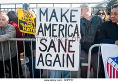 Protesters outside a Trump rally hold sign reading, Make America sane again…